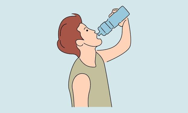Jeune homme boit de l'eau à partir d'une bouteille