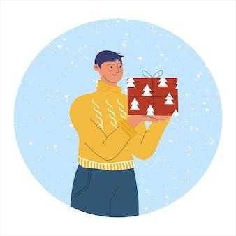 Jeune homme avec un cadeau du nouvel an