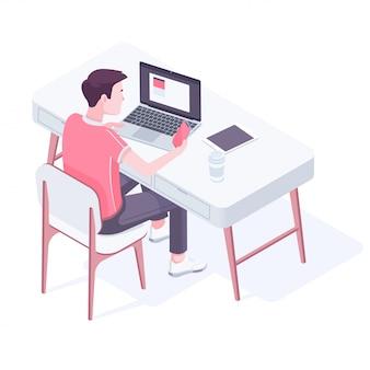 Jeune homme caucasien travaillant dans un bureau moderne.