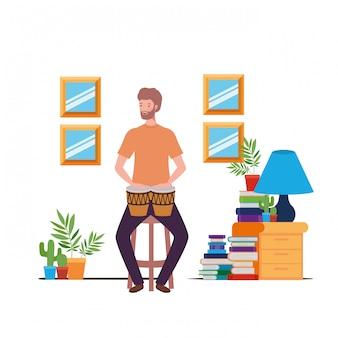 Jeune homme avec congas dans le salon