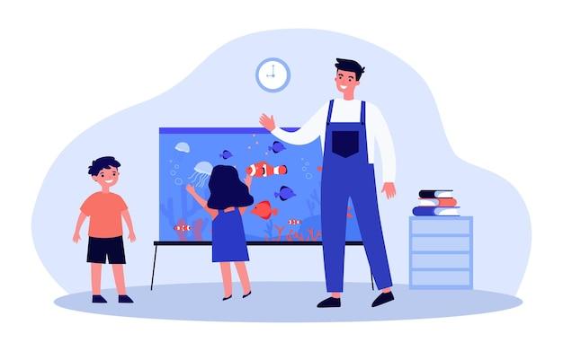 Jeune homme et enfants debout près de l'aquarium. illustration vectorielle plane. enseignant saluant le petit garçon et la fille regardant le poisson. enfance, école, famille, nature, concept animal pour la conception de bannières