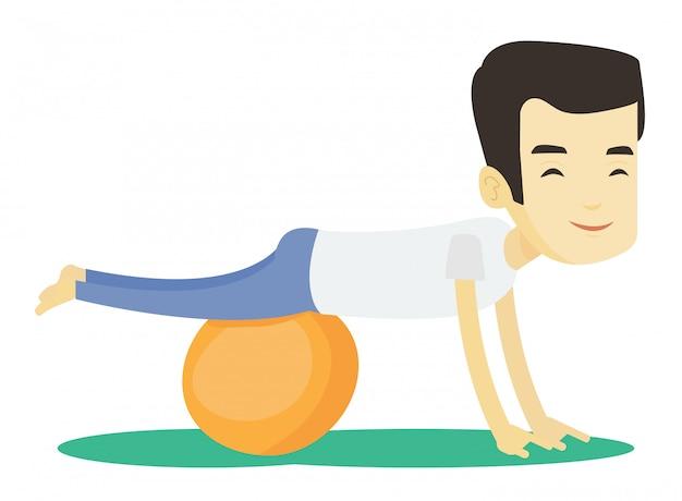 Jeune homme exerçant avec fitball.