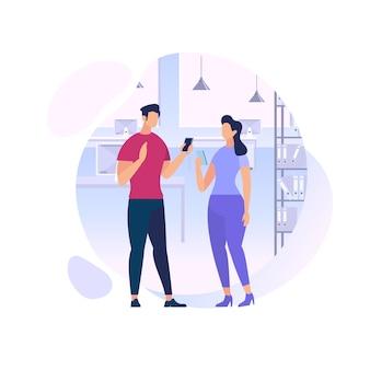 Jeune homme et femme communiquant à l'aide de téléphones