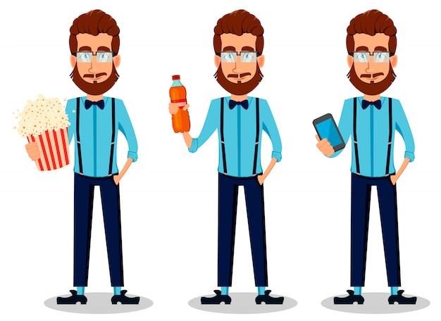 Jeune homme hipster barbu à lunettes