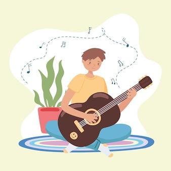 Jeune homme jouant de la guitare