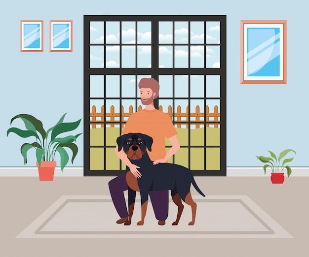 Jeune homme avec une mascotte de chien mignon dans la chambre de la maison