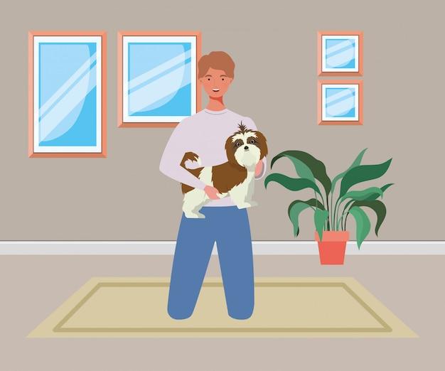 Jeune homme avec une mascotte de chien mignon dans la maison de la chambre