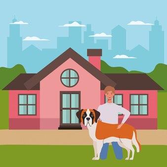 Jeune homme avec une mascotte de chien mignon dans la maison en plein air