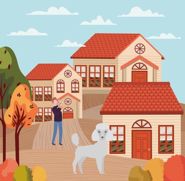 Jeune homme avec des mascottes de chiens mignons dans la scène de la ville en automne