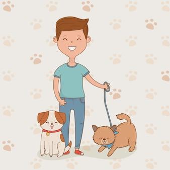 Jeune homme avec des mascottes de chiens mignons
