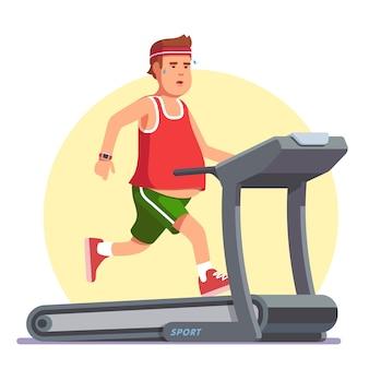 Jeune homme obèse courir sur un tapis roulant