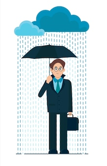Jeune homme avec un parapluie sous la pluie. mauvais temps pluvieux.