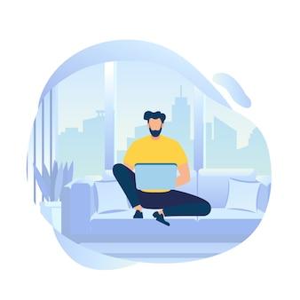 Jeune homme personnage travaille sur un ordinateur portable assis sur un canapé