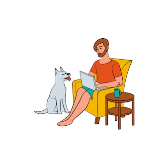 Jeune homme, pigiste travaillant à domicile et chien