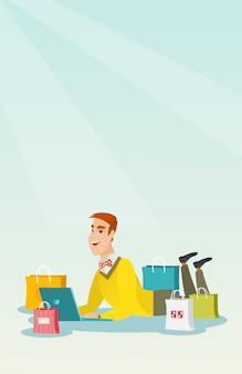 Jeune homme de race blanche faisant des achats en ligne.