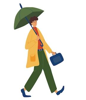 Jeune homme tenant un parapluie, marchant sous la pluie. un homme d'affaires joyeux dans un imperméable revient du travail. saison météo automne automne, jour de pluie. illustration vectorielle de caractère homme.