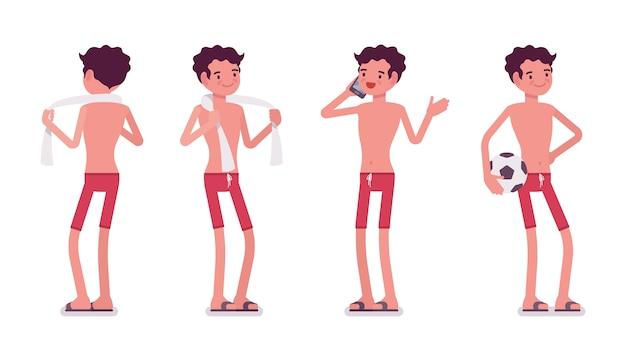 Jeune homme en tenue de plage d'été, debout