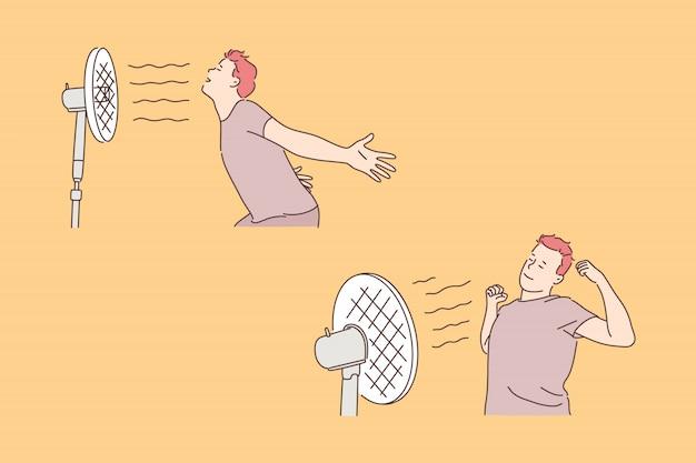 Jeune homme avec ventilateur, concept de fraîcheur et de fraîcheur