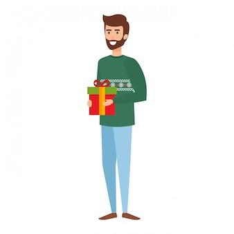 Jeune homme avec des vêtements de noël et des cadeaux
