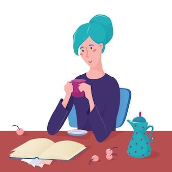 Jeune jolie femme assise à la table, tenant une tasse, une tasse de café, du thé et lisant un livre allongé devant elle
