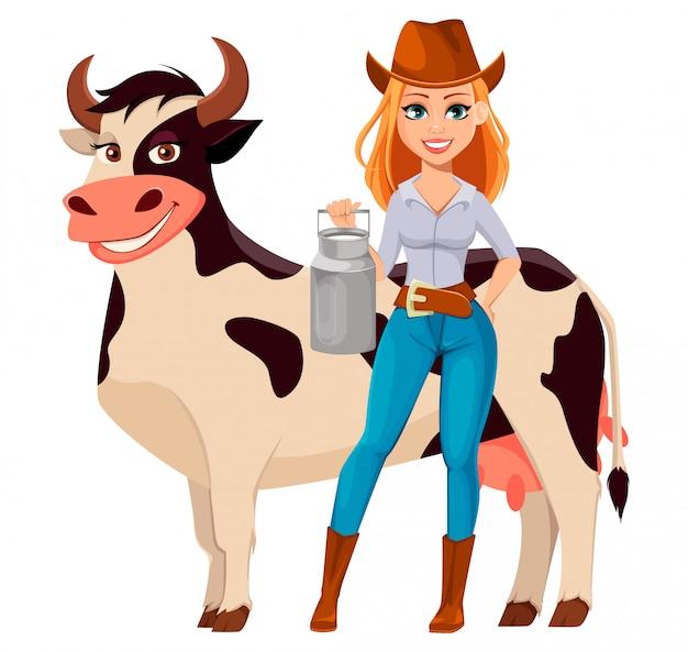 Jeune jolie fermière au chapeau de cowboy