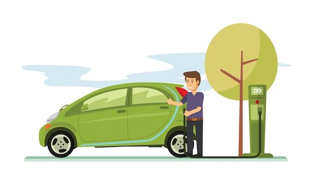 Jeune mec chargeant sa voiture électrique dans le parking