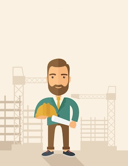Jeune ouvrier du bâtiment tenant un casque et un plan.