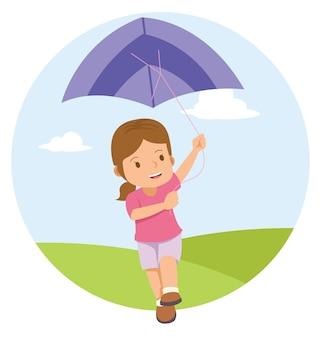 Jeune petite fille jouant au cerf-volant sur le terrain