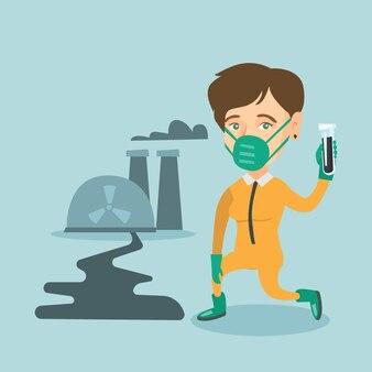 Jeune scientifique caucasien tenant un tube à essai.