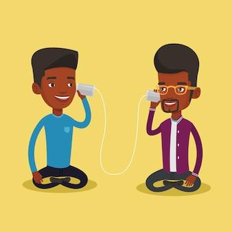 Jeunes amis parler à travers un téléphone en étain.