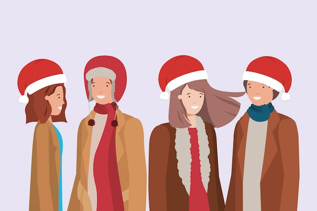 Jeunes couples avec des chapeaux de père noël