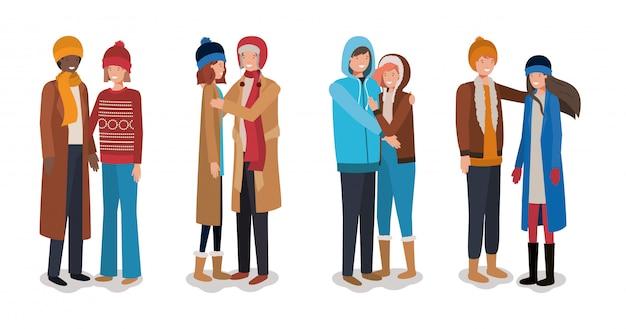 Jeunes couples avec des vêtements d'hiver