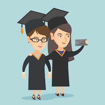 Jeunes diplômés de race blanche faisant selfie.