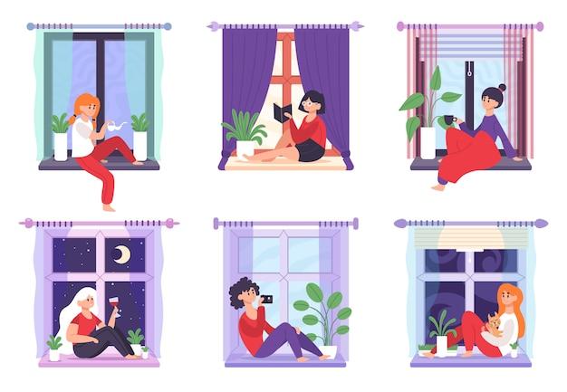 Jeunes femmes assises sur le rebord de la fenêtre