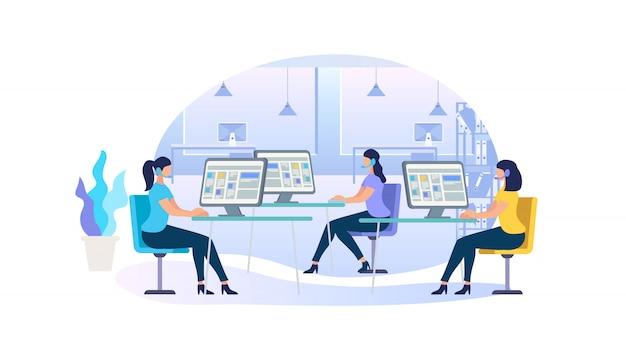 Jeunes femmes dans les casques s'asseoir devant des écrans d'ordinateur