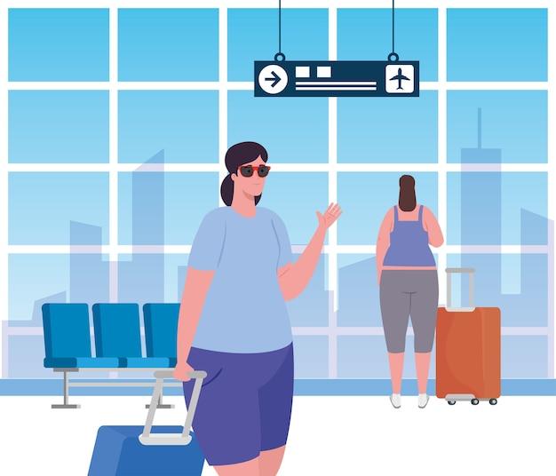 Les jeunes femmes dans le terminal de l'aéroport, passager au terminal de l'aéroport avec des bagages