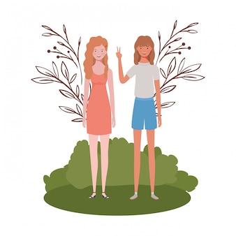 Jeunes femmes debout avec paysage