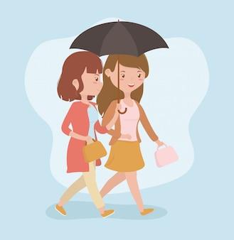 Jeunes femmes marchant avec des personnages d'avatars de parapluie