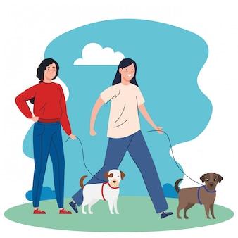 Jeunes femmes, marche, à, chiens, mascottes, dans, paysage