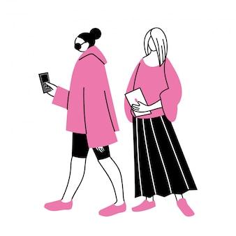 Jeunes femmes utilisant un appareil électronique