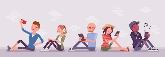 Les jeunes avec des gadgets