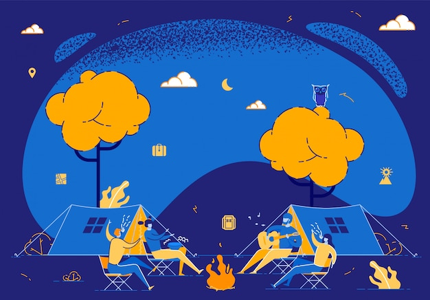 Jeunes gens assis autour d'un feu de camp la nuit