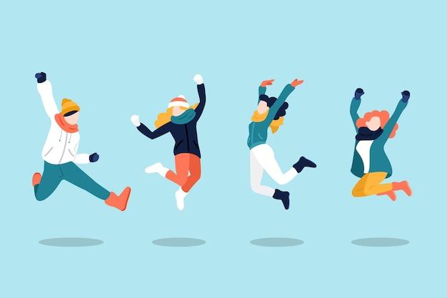 Jeunes gens sautant dans des vêtements d'hiver