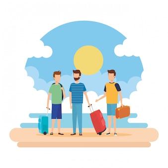 Jeunes hommes avec des valises sur la plage