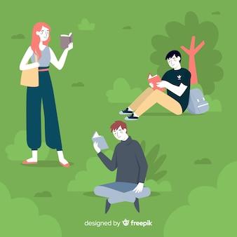 Jeunes lisant dans la nature