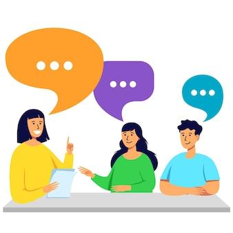 Les jeunes parlent et discutent à la table