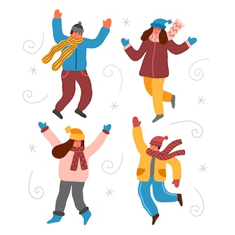 Jeunes portant des vêtements d'hiver sautant