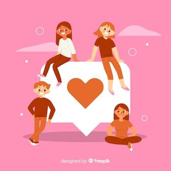 Jeunes avec le symbole du coeur rouge