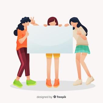 Jeunes tenant une bannière