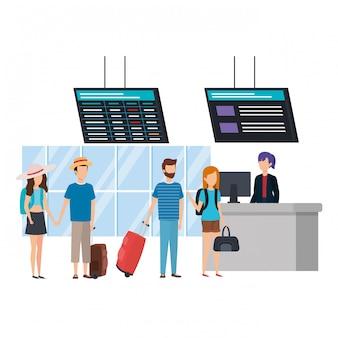 Jeunes avec valises à l'aéroport